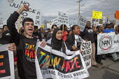Inkster, Michigan - Hundreds marched to protest the beating of Floyd Dent, an African-American auto worker, by white police officers. The beating was captured on a police car's video camera and was wi... - Jim West - 03-04-2015