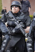 Toledo, Ohio - Armed Swat Police in riot gear protect members of the neo-Nazi National Socialist Movement (NSM) as they held a rally. Several hundred people turned out to protest against the Nazis. - Jim West - 18-04-2015
