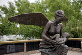 Wallace, Louisiana - The Whitney Plantation, a sugar plantation that has been turned into a museum to tell the story of slavery. A bronze sculpture by Rod Moorhead in the plantations Field of Angels s... - Jim West - 16-05-2015