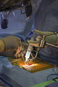 Colorado Doctor injects anaesthetic performing minimally invasive lumbar spine surgery on a patient, Swedish Medical Centre. A portable x-ray machine helps guide the surgery - Jim West - 23-07-2015