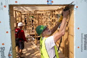 Detroit Christian volunteers Habitat for Humanity home building affordable homes. A week-long campaign to build or refurbishing 12 houses Morningside, Michigan, Detroit - Jim West - 17-08-2015