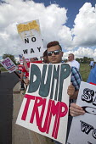 USA Protest at Donald Trump anti-immigrant anti-woman anti-veteran views. Republican fundraising event Michigan - Jim West - 2010s,2015,activist,activists,adolescence,adolescent,adolescents,America,American,americans,campaign,campaigner,campaigners,CAMPAIGNING,CAMPAIGNS,candidate,CANDIDATES,DEMOCRACY,DEMONSTRATING,demonstra