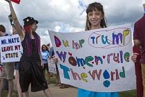 USA Protest at Donald Trump anti-immigrant anti-woman anti-veteran views. Republican fundraising event Michigan - Jim West - 2010s,2015,activist,activists,America,American,americans,campaign,campaigner,campaigners,CAMPAIGNING,CAMPAIGNS,candidate,CANDIDATES,child,CHILDHOOD,CHILDREN,DEMOCRACY,DEMONSTRATING,demonstration,DEMON