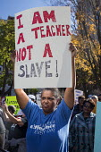 Michigan Teachers and other school workers from Detroit rally protest against healthcare and other cuts demanded by the school district authority. I am a teacher not a slave! - Jim West - 03-11-2015