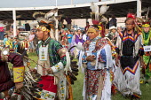 Rosebud Sioux Tribe Annual Wacipi Fair on their Reservation, South Dakota. Grass Dancers during the Grand Entry - Jim West - 03-07-2015