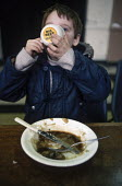 A child enjoys a proper meal at a soup kitchen set up during the miner strike at Armthorpe, Yorkshire - Katalin Arkell - 01-11-1984