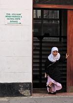 Muslim girl leaving a Madrasah school in East London. - Luana Gomes - ,&,2000s,2006,Alcoran,al-qur'a¯n,alquran,belief,child,CHILDHOOD,children,cities,city,conviction,dress,edu,edu education,educate,educating,education,educational,faith,female,females,girl,GIRLS,GOD,haj