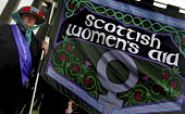 Thousands gather to take part in a re-enactment to commemorate the Suffrage procession 100 years earlier, on the same day in 1909, took to the streets of Edinburgh in the struggle for the vote and rig... - Mike Day - 2000s,2009,ACE,activist,activists,age,ageing population,as,banner,banners,campaign,campaigner,campaigners,campaigning,CAMPAIGNS,commemorate,commemorates,commemorating,commemoration,COMMEMORATIONS,cult
