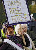 Damn rebel bitches: Thousands gather to take part in a re-enactment to commemorate the Suffrage procession 100 years earlier, on the same day in 1909, took to the streets of Edinburgh in the struggle... - Mike Day - 2000s,2009,ACE,activist,activists,age,ageing population,as,banner,banners,campaign,campaigner,campaigners,campaigning,CAMPAIGNS,commemorate,commemorates,commemorating,commemoration,COMMEMORATIONS,cult