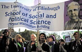 University of Edinburgh School of Social and Political Science banner: Thousands gather to take part in a re-enactment to commemorate the Suffrage procession 100 years earlier, on the same day in 1909... - Mike Day - 2000s,2009,ACE,activist,activists,as,banner,banners,campaign,campaigner,campaigners,campaigning,CAMPAIGNS,commemorate,commemorates,commemorating,commemoration,COMMEMORATIONS,culture,democracy,DEMONSTR