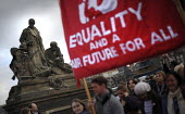 Equality and a Fair future for all: Thousands gather to take part in a re-enactment to commemorate the Suffrage procession 100 years earlier, on the same day in 1909, took to the streets of Edinburgh... - Mike Day - 2000s,2009,ACE,activist,activists,as,banner,banners,campaign,campaigner,campaigners,campaigning,CAMPAIGNS,commemorate,commemorates,commemorating,commemoration,COMMEMORATIONS,culture,democracy,DEMONSTR