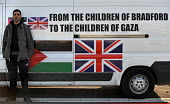 From the children of Bradford. A member of the British Viva Palestina Aid Convoy to Gaza with his vehicle, as the convoy passes through France on a 5000 mile journey by road to Gaza following Israels... - Mike Day - 2000s,2009,activist,activists,Aid,assistance,attack,attacking,CAMPAIGN,campaigner,campaigners,CAMPAIGNING,CAMPAIGNS,charitable,charities,charity,CHILD,CHILDHOOD,children,convoy,DEMONSTRATING,demonstra