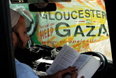 Gloucester help for Gaza. A member of the British Viva Palestina Aid Convoy to Gaza waits in his vehicle as the convoy passes through customs in Morocco, on a 5000 mile journey by road to Gaza followi... - Mike Day - &,2000s,2009,activist,activists,Africa,african,africans,against,Aid,Alcoran,al-qur'a¯n,alquran,arab,arabs,assistance,attack,attacking,belief,CAMPAIGN,campaigner,campaigners,CAMPAIGNING,CAMPAIGNS,char