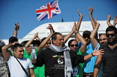 Members of the British Viva Palestina Aid Convoy to Gaza as the convoy passes through border controls at Tanger, Morocco on its 5000 mile journey by road to Gaza following Israels devastating attack d... - Mike Day - 18-02-2009