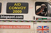 A member of the British Viva Palestina Aid Convoy to Gaza with his vehicle as the convoy waits to pass through border controls from Libya into Egypt, on a 5000 mile journey by road to Gaza following I... - Mike Day - 2000s,2009,activist,activists,african,Aid,Arab,Arabic,Arabs,assistance,attack,attacking,border,CAMPAIGN,campaigner,campaigners,CAMPAIGNING,CAMPAIGNS,charitable,charities,charity,controls,convoy,DEMONS