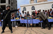 British MP George Galloway (C) waits to speak at a public gathering in Gaza. - Mike Day - 10-03-2009