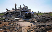 A Palestinian man stands among the rubble and wreckage of his home, following Israels attack on Gaza during December 2008 and January 2009 which killed more than 1400 people. Gaza City, Palestine, Mar... - Mike Day - 10-03-2009