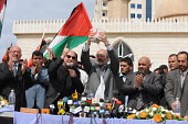 British MP George Galloway hands over bundles of British aid in currency to Hamas Deputy Prime Minister Ziad al-Zaza during a public ceremony in Gaza. - Mike Day - 2000s,2009,activist,activists,aid,arab,arabs,assistance,CAMPAIGN,campaigner,campaigners,CAMPAIGNING,CAMPAIGNS,cash,ceremonies,ceremony,charitable,charities,charity,convoy,currency,DEMONSTRATING,demons