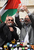 British MP George Galloway hands over bundles of British aid in currency to Hamas Deputy Prime Minister Ziad al-Zaza during a public ceremony in Gaza. - Mike Day - ,2000s,2009,activist,activists,aid,arab,arabs,assistance,CAMPAIGN,campaigner,campaigners,CAMPAIGNING,CAMPAIGNS,cash,ceremonies,ceremony,charitable,charities,charity,convoy,currency,DEMONSTRATING,demon