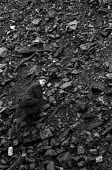 Miner Idris Moseley picking coal, riddling, for his pensioner neighbour at old tip or slag heap in Pontlottyn, South Wales during 1972 miners strike - Martin Mayer - 25-01-1972