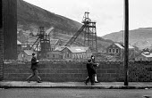 Children walking home from school in shadow of Pontlottyn colliery pit wheel. South Wales during 1972 miners strike - Martin Mayer - 25-01-1972