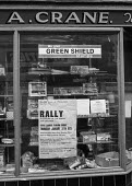 Local shop in Pontlottyn, South Wales showing a poster for a rally supporting miners during 1972 miners strike - Martin Mayer - 1970s,1972,dispute,DISPUTES,EARNINGS,EQUALITY,Green Shield stamps,Income,INCOMES,INDUSTRIAL DISPUTE,inequality,living wage,Local,low pay,Low Income,low paid,low pay,Marginalised,member,member members,