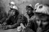 Exhausted members of a rescue team at Lofthouse colliery, West Yorkshire, give details of pregress in rescuing their fellow miners during the pit disaster that claimed 7 lives. - Martin Mayer - LBR,1970s,1973,accident,accidental,accidents,accidents at work,casualties,Coal Industry,Coal Mine,coalfield,coalindustry,collieries,colliery,death,deaths,DIA,died,disaster,disasters,employee,employees