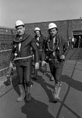 Underwater mines rescue crew in wetsuits set out on another attempt to free 7 miners trapped in the flooded Lofthouse colliery, West Yorkshire - Martin Mayer - 1970s,1973,accident,accidental,accidents,accidents at work,BAD,breathing apparatus,Coal Industry,Coal Mine,coalfield,coalindustry,collieries,colliery,crew,danger,dangerous,dangers,death,deaths,DIA,die