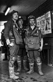A rescue crew waiting to make another attempt to free 7 miners trapped in the flooded Lofthouse colliery, West Yorkshire - Martin Mayer - 1970s,1973,accident,accidental,accidents,accidents at work,BAD,breathing apparatus,Coal Industry,Coal Mine,coalfield,coalindustry,collieries,colliery,crew,danger,dangerous,dangers,death,deaths,DIA,die