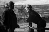 Miners at Oakdale pit, South Wales, just before the 1974 miners strike. - Martin Mayer - 1970s,1974,capitalism,capitalist,change,Coal Industry,Coal Mine,coalfield,coalindustry,collieries,colliery,coming off,communicating,communication,conversation,conversations,dialogue,discourse,discuss,