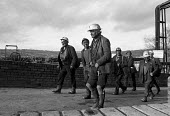 Miners leaving work at Oakdale pit, South Wales just before 1974 strike. - Martin Mayer - 1970s,1974,capitalism,capitalist,change,Coal Industry,Coal Mine,coalfield,coalindustry,collieries,colliery,coming off,disputes,EBF,Economic,Economy,employee,employees,Employment,INDUSTRIAL DISPUTE,Ind
