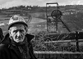 Miner from Oakdale pit, South Wales, just before 1974 strike. - Martin Mayer - 1970s,1974,capitalism,capitalist,change,Coal Industry,Coal Mine,coalfield,coalindustry,collieries,colliery,coming off,disputes,EBF,Economic,Economy,employee,employees,Employment,head,helmet,HELMETS,IN