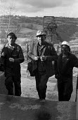 Miners leaving work at Oakdale pit, South Wales, just before the 1974 miners strike. - Martin Mayer - 1970s,1974,capitalism,capitalist,change,Coal Industry,Coal Mine,coalfield,coalindustry,collieries,colliery,coming off,disputes,EBF,Economic,Economy,employee,employees,Employment,head,INDUSTRIAL DISPUT