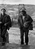 Miners leaving work at Oakdale pit, South Wales, during work to rule, just before 1974 strike. - Martin Mayer - 1970s,1974,capitalism,capitalist,change,Coal Industry,Coal Mine,coalfield,coalindustry,collieries,colliery,coming off,disputes,EBF,Economic,Economy,employee,employees,Employment,head,INDUSTRIAL DISPUT