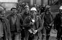Miners from Rockingham colliery, near Barnsley leaving work - Martin Mayer - 1970s,1974,capitalism,capitalist,change,Coal Industry,Coal Mine,coalfield,coalindustry,collieries,colliery,coming off,EBF,Economic,Economy,employee,employees,Employment,Industries,industry,job,jobs,lb