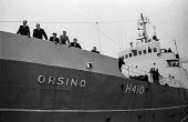 The Orsino sets sail from Hull docks for Iceland, the first experimental mothership for the trawler fleet, watched by seamen and dockers - Martin Mayer - 29-10-1968