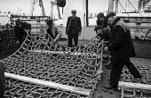 Fishermen on a trawler in Hull dock prepare nets prior to setting off for Icelandic fishing grounds - Martin Mayer - 29-10-1968