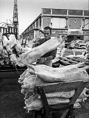 Traditional dock work, East India dock, London - manhandling frozen meat piecemeal - just before containerisation changed dock work for ever. - Martin Mayer - 06-07-1970