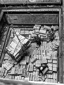 W. Weddel & Co importing frozen mutton and beef from New Zealand. The hold of a traditional cargo ship docked in East India docks, London - full of individual cargo items to unload. Containerisation d... - Martin Mayer - 06-07-1970