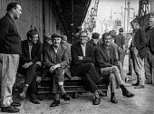 Dockers waiting to start work in the East India docks, London, shortly before the old docks were closed because of the opening of a new container docks at Tilbury. - Martin Mayer - 06-07-1970
