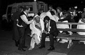IRA Bombing of The Grand Hotel, Brighton. Hotel staff helping a guest and a journalist interviewing shocked and bloodied delegates to the Conservative Party conference gather outside The Grand Hotel,... - Martin Mayer - 1980s,1984,Asbestos,ASBESTOSIS,assassination attempt,attack attacking,blood bleeding,bloodied,blown up,Bomb,bomb bombs,bombing,bombings,BOMBS,Brighton,casualty casualties,colin adamson,conference,conf