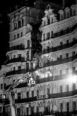 Firemen check for injured guests at the heavily damaged Grand Hotel, Brighton, in the aftermath of the bomb attack in which the IRA attempted to assassinate Prime Minister Margaret Thatcher - Martin Mayer - UCW,1980s,1984,adult,adults,Asbestos,ASBESTOSIS,assassination attempt,attack,attack attacking,attacking,bomb,bomb bombs,bombing,bombings,BOMBS,Brighton,building,buildings,collapsed,conference,conferen