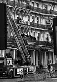 Firemen still checking for damage at the Grand Hotel, Brighton, the morning after the bomb attack in which the IRA attempted to assassinate Prime Minister Margaret Thatcher - Martin Mayer - 1980s,1984,adult,adults,Asbestos,ASBESTOSIS,assassination attempt,attack,attack attacking,attacking,bomb,bomb bombs,bombing,bombings,BOMBS,Brighton,building,buildings,checking,collapsed,conference,con