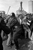 Docks strike 1972. Pickets at Neap House Wharf, near Scunthorpe, Lincs, which was being used by government to try to bypass the strike, attempt to stop the unloading of goods - Martin Mayer - ,1970s,1972,adult,adults,anti union legislation,CLJ,confront,confrontation,confronted,confronting,DISPUTE,DISPUTES,DOCK,Dock strike,dockers strike,Docks,Docks Labour Scheme,docks strike,force,goods,go