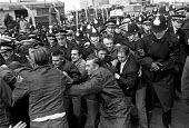 Docks strike 1972. Pickets at Neap House Wharf, near Scunthorpe, Lincs, which was being used by government to try to bypass the strike, attempt to stop the unloading of goods - Martin Mayer - ,1970s,1972,adult,adults,anti union legislation,CLJ,confront,confrontation,confronted,confronting,DISPUTE,DISPUTES,DOCK,Dock strike,Docks,Docks Labour Scheme,docks strike,force,goods,government,harbor