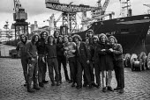 Young shipyard workers at Govan Shipyards, Glasgow, part of Upper Clyde Shipyards, after vote to occupy yard in a 'work-in' to fight threatened closure - Martin Mayer - 1970s,1971,adolescence,adolescent,adolescents,AEU,apprentice,apprentices,apprenticeship,closed,closing,closure,closures,Clyde,crane,cranes,democracy,Glasgow,Govan,hair,in,long,male,man,member,member m