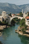 The original Stari Most the old 16th century Ottoman bridge over the Neretva river in Mostar, Bosnia in 1990, before it was blown up during the civil war by Croatian forces. It was eventually rebuilt... - Martin Mayer - 07-09-1990