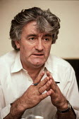 Radovan Karadzic, leader of the Bosnian Serb nationalist party SDS (Serbian Democratic party), being interviewed at his flat in Sarajevo during the election after the breakup of Yugoslavia. - Martin Mayer - ,1990,1990s,balkan,balkans,bosnian,bosnians,Democratic Party,Eastern Europe,eu,european,europeans,flat,Herzegovina,interview,INTERVIEWED,INTERVIEWER,INTERVIEWING,interviews,Karadzic,leader,nationalism