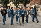 Denim clad girls walk confidently through the centre of Sarajevo, Bosnia, after the break up of Yugoslavia. Denim was a Western import highly prized by the young during the Communist and post Communis... - Martin Mayer - 07-09-1990