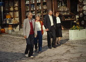 Couples taking an evening stroll through Sarajevo old town, Bosnia. - Martin Mayer - 07-09-1990